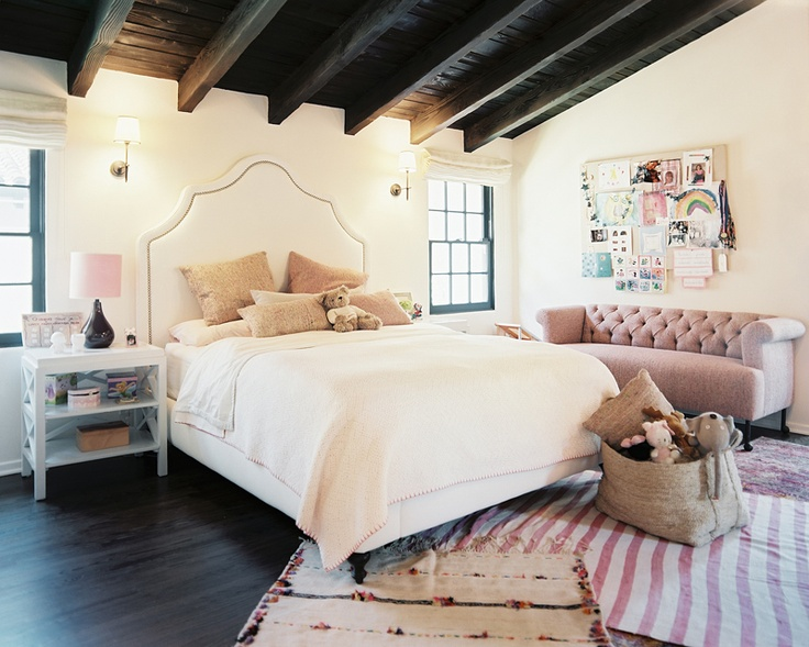 Headboard shape, layered rugs, wooden beams, tufted sofa, cool kids room Home