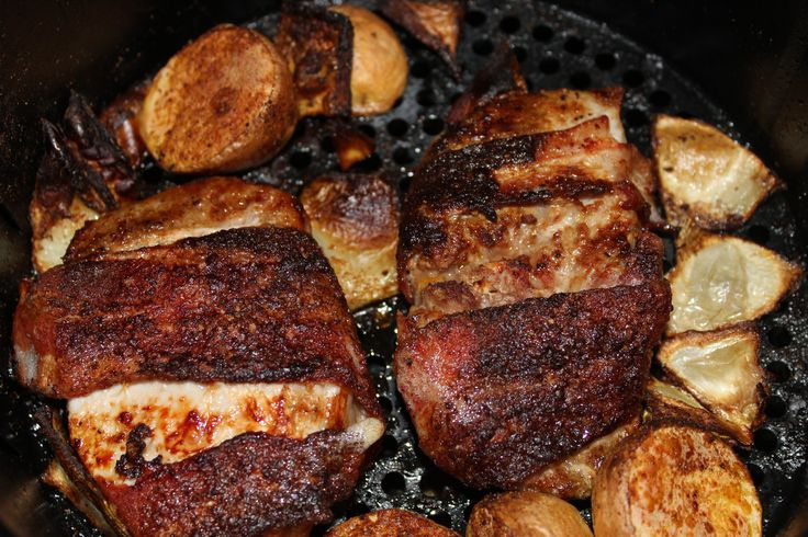 Bacon wrapped pork loin. Served with golden potatoes and onion wedges. Air fried at 390 for 25 min. Flipped half way. Marinated with olive oil and seasoned with cajun spices.