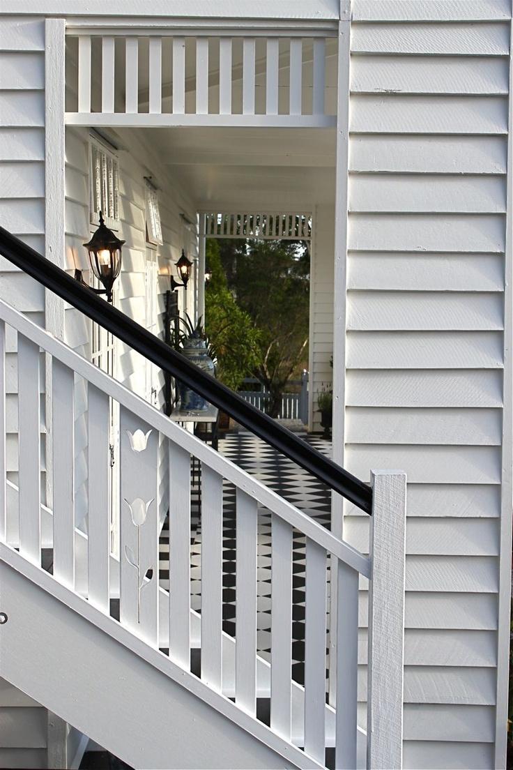 Steps shutters, French doors + timber detail. Verandah House Interiors