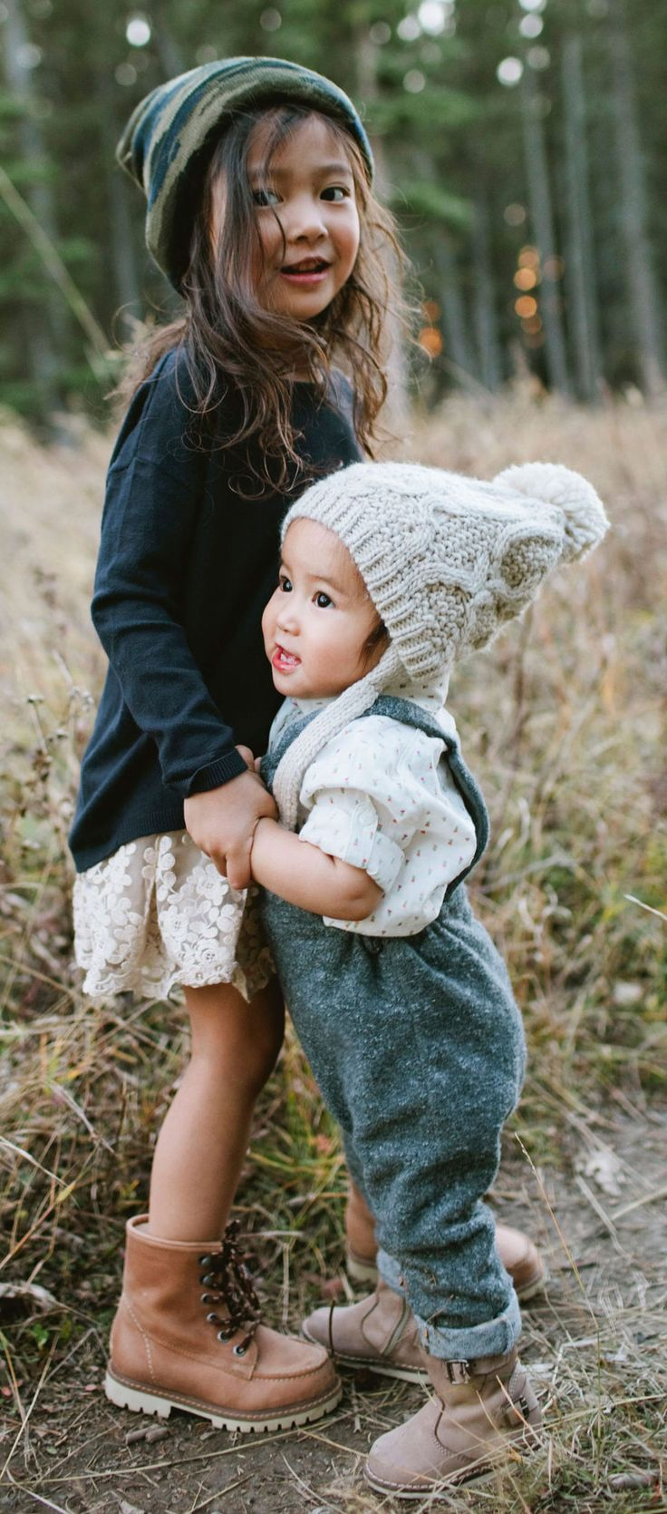 Start 'em young and they will always know proper style. Lace skirt, boots, adorable jumper, & hats galore...