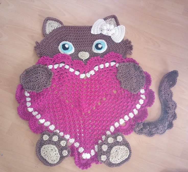 Sassy kitty heart rug made by Crochet by Angela, I love this girly version with a pink heart!   Pattern from: https://irarott.com/Kitty_Cat_Heart_Rug_Crochet_Pattern.html