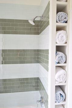 Cheap & fun shower tile idea: wide subway tile stripes! Plus towel cubbies for storage.