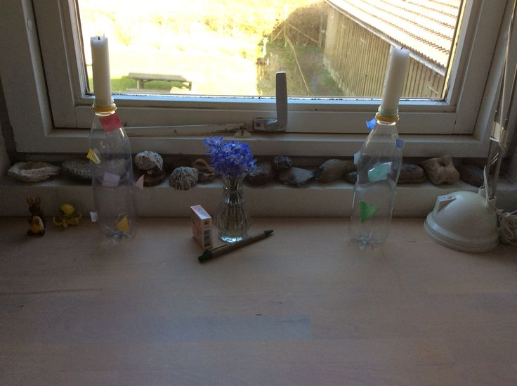 Some candlesticks made of bottles with paper triangles on in different colours #madebyme