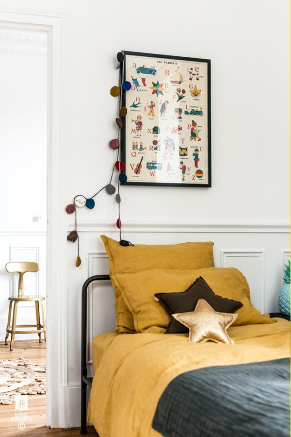 Mustard yellow in the children's bedroom in a fabulous home in Fontainebleau, France. Royal Roulotte.