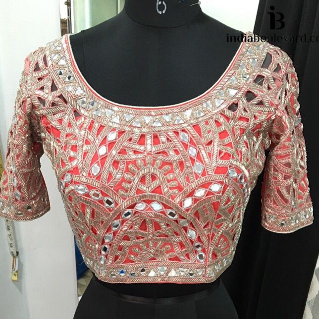 It never stops, we are obsessed with mirror work trend. A red cutwork blouse with mirror and beading work. Perfect to wear with a saree or lehenga. For all prices and inquries, please email us at inquiries@indiaboulevard.com or visit us at indiaboulevard.com #indiancouture #desicouture #indianwear #desifashion #indianfashion #fashionista #customindianwear #allthingsindian #newdesigners #lehenga #bridal #indianembroidery #couture #ootd #aw15 #igers #instagood #asianbride #bollywood #autumn #a