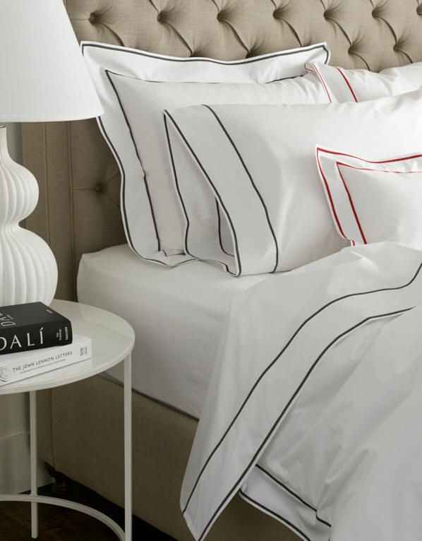 Ansonia embroidered bed linens, sheets, and duvet covers.