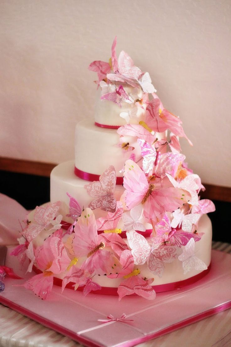 butterfly square wedding cakes | White iced wedding cake over four round tiers decorated with pink ...