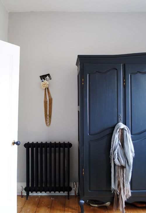 "Belgium wardrobe in Cassandra Ellis & Ed Prichard's London home. Technically, it's painted ""Off Black"" by Farrow & Ball, but it gives a navy vibe."