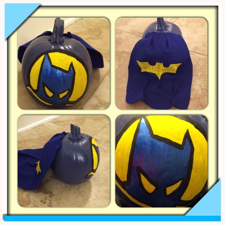Batman pumpkin. Pumpkin spray painted, batman hand painted, cape made of felt and hot glued to pumpkin.