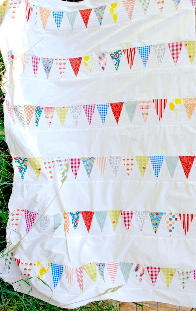 """I really like the idea of a bunting quilt like this, but I'd put a string-like """"spacer block"""" of sorts between the triangles."""