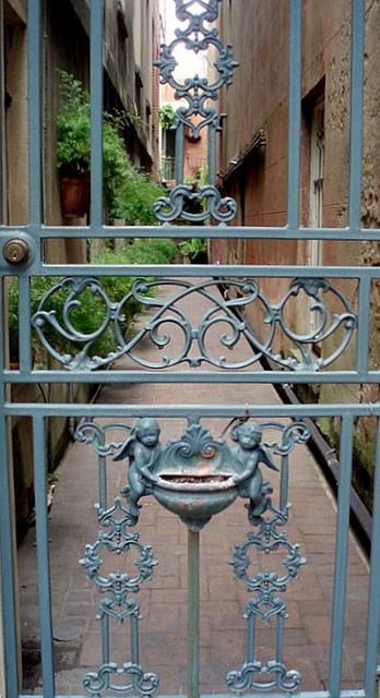 Love those little baby cherubs!  Savannah Iron Gate by RIRed1, via Flickr