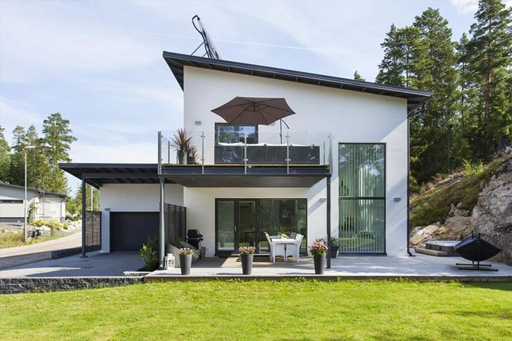 Modern stone house with white interiors