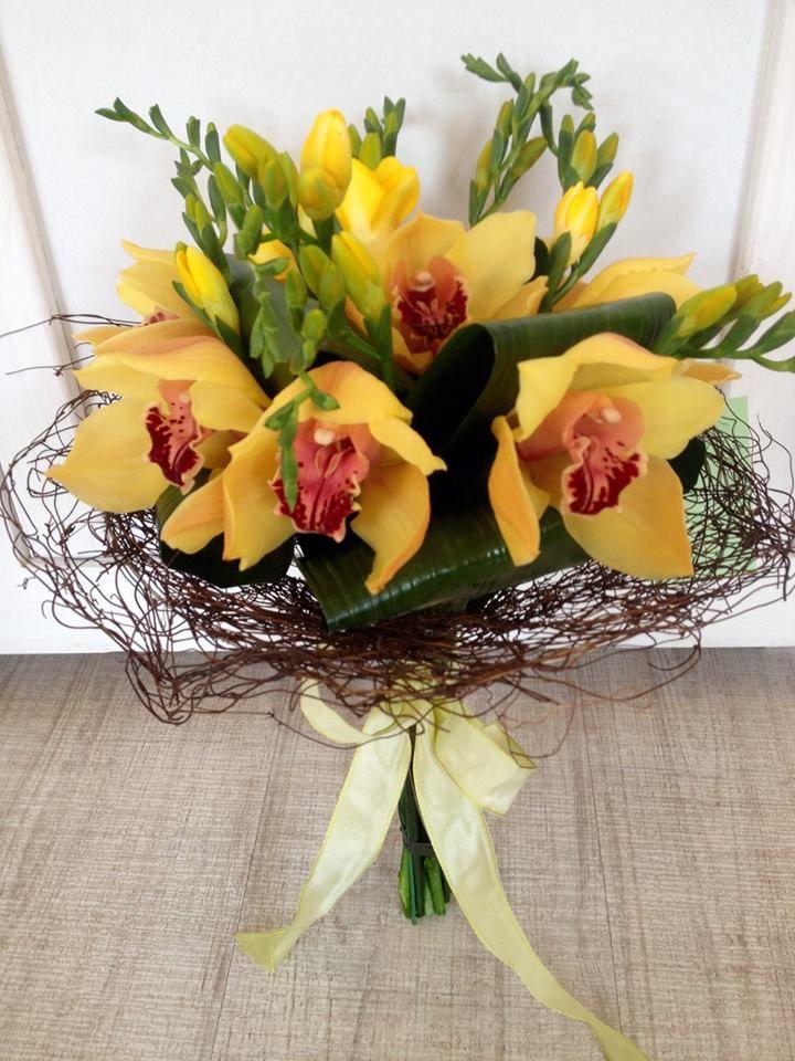 Yellow orchids bouquet by Atelier Floristic Aleksandra