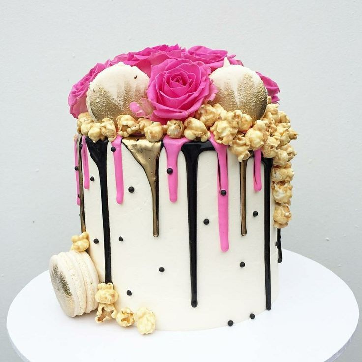 Black gold and hot pink drip cake