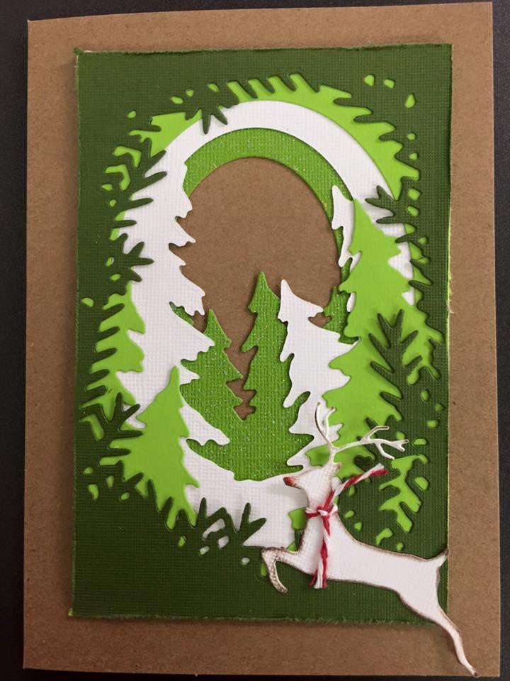 Rudolf jumping through the woods - Scrapbook.com Using Xcut Build-A-Scene Dies Forest
