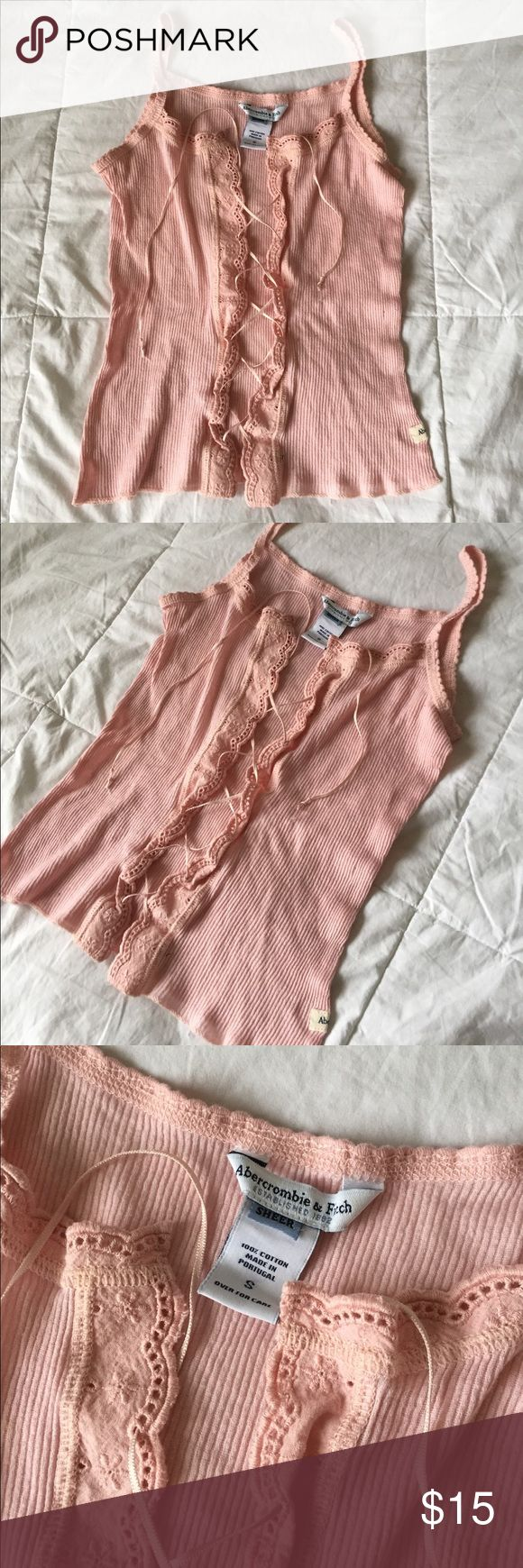 Vintage Abercrombie and fitch top Light pink lace up crop top!! Lace detail and ribbed, definitely an XS not small. Tiny hole on side as pictured. Shirt is unique and probably 10- 12 years old! Abercrombie & Fitch Tops