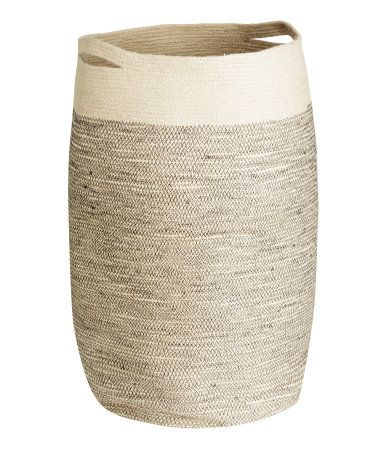 Laundry basket in jute with two handles. Diameter approx. 35 cm, height 65 cm.