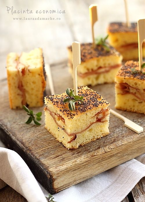 "bread, cheese, and sliced deli meat! :D {recipe in another language but you could use focaccia bread or this looks like a ""cornbread"" type of mix that is used here?)"