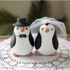 Penguin wedding cake topper #3  Hahahaha that would be so funny to have as our cake topper! LOL