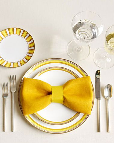 This may seem silly but I imagined this with the striped napkin and ribbon so it would look like the groomsmens' bowties on the plates.    Tie ribbon in the middle of a folded napkin and ta da......a great-looking bow!