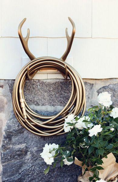 Antler hose holder on LindO Designs: Garden Glamorous. #gardenhose #antlers