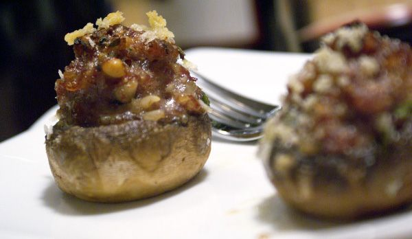 Stuffed mushrooms with sausage, pine nuts and herbs.