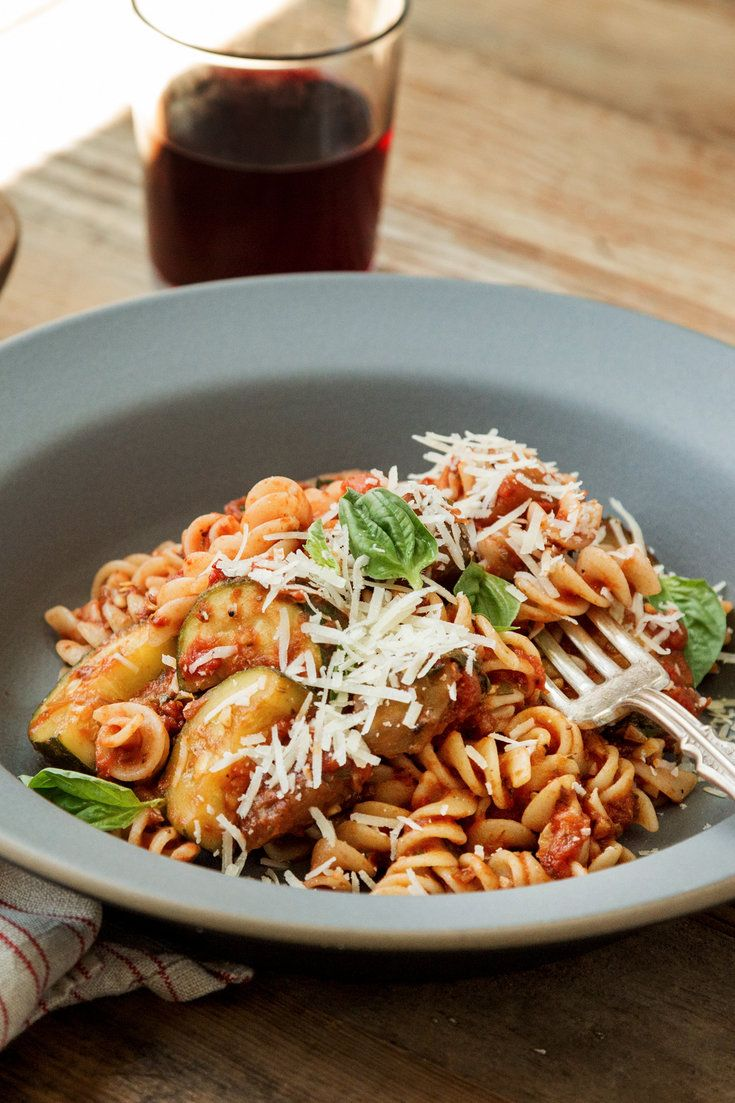 NYT Cooking: This timeless summer pasta dish was brought to The Times in 1991 by Pierre Franey in one of his 60-Minute Gourmet columns. Like so many of his dishes, it is at once elegant and easy, and no trouble to put together on a weeknight. Sauté the sliced eggplant and zucchini until golden while you make a quick sauce of canned crushed tomatoes, olive oil, garlic and herb...