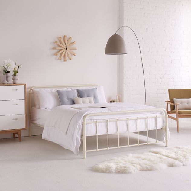 Pure retro style, inspired by the classic turn of the century hospital dormitory beds, we loved the versatility this design offers. Solidly made in steel, with an ivory powder coating and a sprung slatted wooden base. Available in double and King-size.