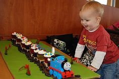 """Train themed party - cargo cars carrying cupcakes with various """"cargo"""" on them (types of candy)"""