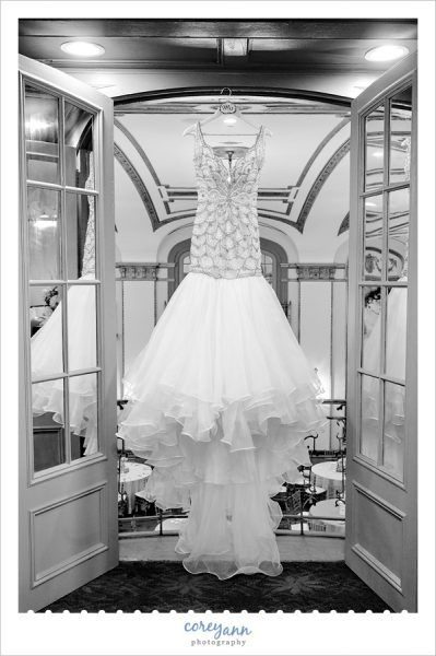 Custom Jovani mermaid style art deco wedding gown by Henri's Cloud Nine hanging up at the Tudor Arms Hotel in Cleveland, Ohio