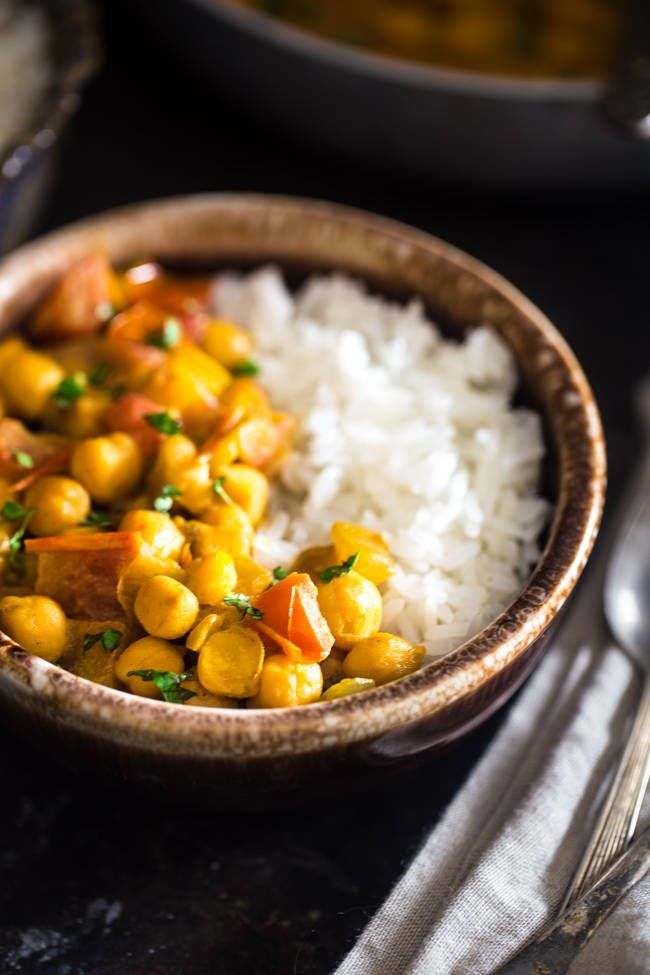 Vegan Chickpea Curry - A gluten free, 20-minute, weeknight dinner that's made extra creamy with coconut milk! It's perfect for a cozy, Meatless Monday meal! | Foodfaithfitness.com | @FoodFaithFit