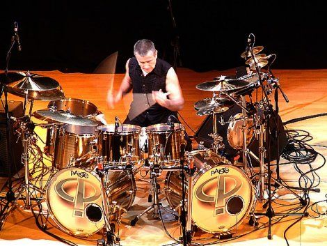 Carl Palmer's Paiste drum set! One of only three kits made (in 2002) from Paiste cast 2002 cymbal alloy. Carl's set consists of 10x12 and 10x14 hanging toms; 14x16 and 16x16 floor toms; two 16x22 bass drums, and Carl also has a Paiste 5.5x14 snare that will come with the set. These 7 drums would have had a retail price of almost $40,000 when you include the snare drum. From Steve Maxwell Vintage Drums