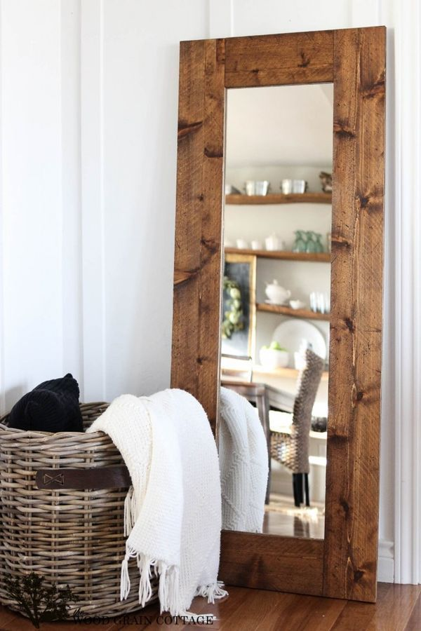 Farmhouse style: Warm wood, large leaning/standing framed mirror. DIY project.
