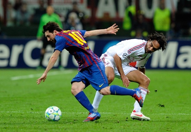 Alessandro Nesta of AC Milan and Lionel Messi of Barcelona