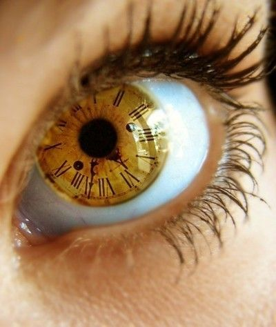clock reflection inside eye