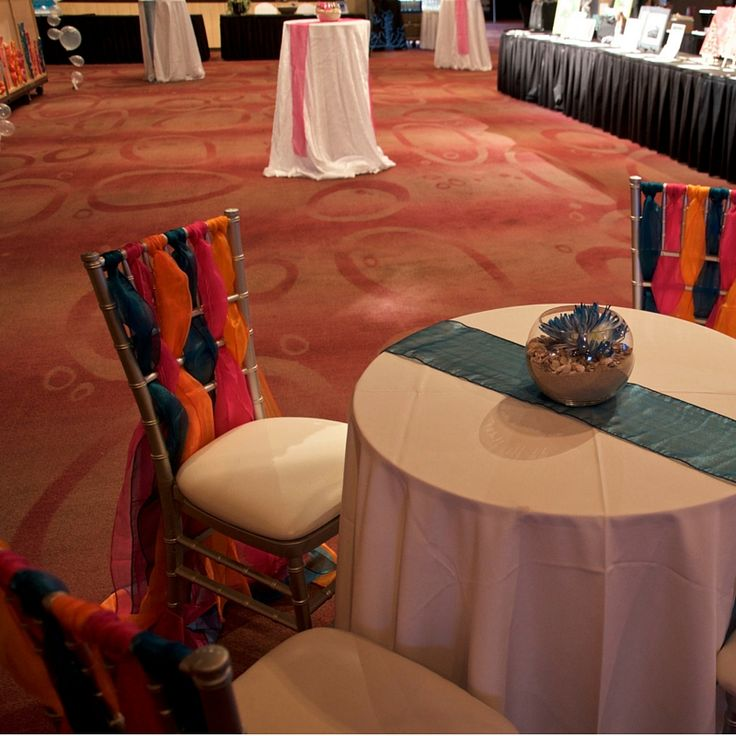 Cocktail tables in a variety of heights create conversation areas at this Under the Sea inspired event.