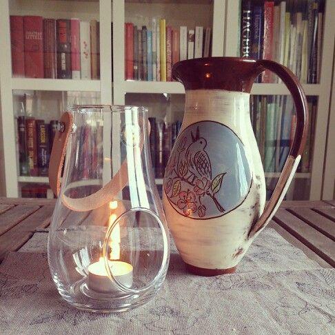 Another apple flower decorated water mug/caraffe. With holmegaard lantern, nice combination.   Earthenware mug by Potter Ingrid Kristne Lund.