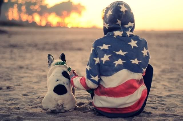 from the Fashion Salade blog, a day on the beach photo with american flag hoodie (must have) and the dog. Love this.