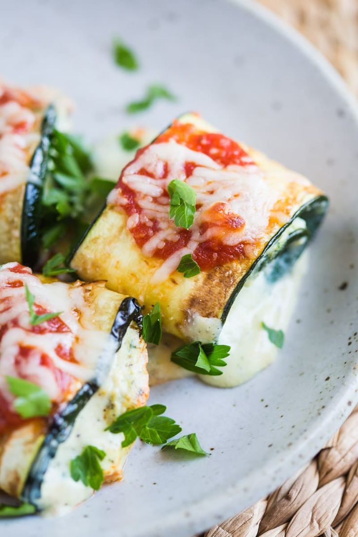 These Zucchini Lasagna Rolls are super easy to throw together, low carb, and fully vegetarian! A dish the whole family will love!