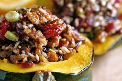Baked acorn squash stuffed with wild rice, toasted pecans and dried cranberries.