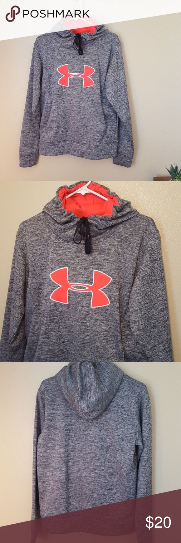 Under Armour women's grey Coral sweatshirt medium Best women's grey sweatshirt is Under Armour brand size medium cold gear. Fleece-lined. One large pocket in front with two hand openings. Drawstring Hood this is in great Under Armour Sweaters