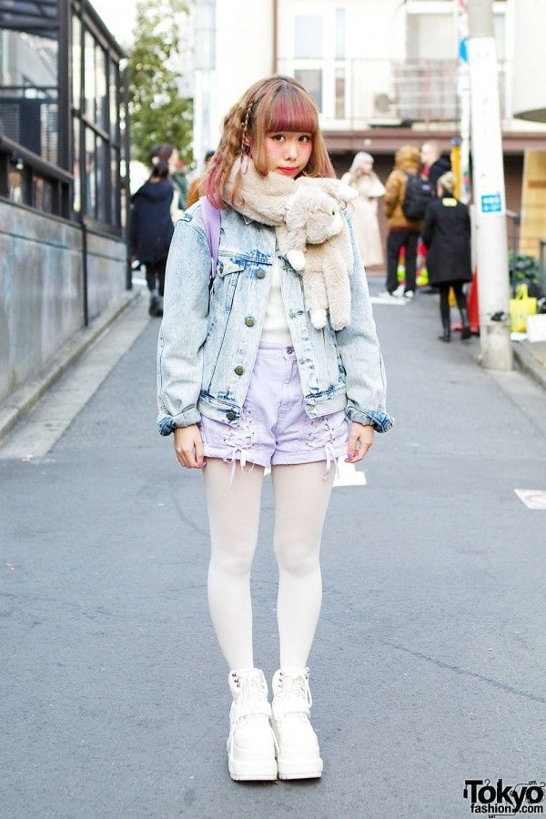 "Tetsuko (aka ""Peco"") is an 18-year-old model with a super kawaii sense of style who we met in Harajuku. You might remember her previous snaps from summer 2013. This time, her look featured blonde and purple hair with two thin braids.Peco is wearing a WEGO top and denim jacket with lilac denim shorts by Candy Stripper. Her lilac backpack is also from WEGO, and she bought her heart platforms from the flea market. Her muffler is Syrup, and her hearts ring is Candy Stripper. (Tokyo Fashion…"