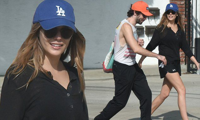 Elizabeth Olsen and beau Robbie Arnett appeared smitten as ever Sunday in LA, where they were seen taking in a relaxing stroll together. The actress repped the LA Dodgers with a blue ball cap.