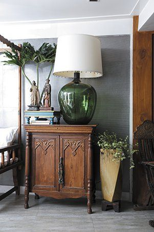 As random as the pieces in her home, so are its origins. The lamp with a green vinegar vessel as its base was a Valentine's gift from her boyfriend, Dion Guanio who is a contractor. Jinky spotted the lamp at another renovation Dion was working on. After mentioning how much she liked the lamp, Dion acquired it and gave it to her on the day of hearts. Now it adds to a lovely vignette atop a wooden cabinet.
