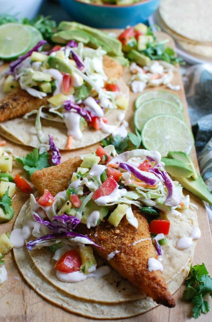 Easy Fish Tacos with Spicy Pineapple Salsa is a quick and easy meal that doesn't lack flavor! These are the perfect way to mix up taco night with baked breaded cod tacos topped with a spicy pineapple salsa and a spicy slaw. // A Cedar Spoon #TrustGortons #ad