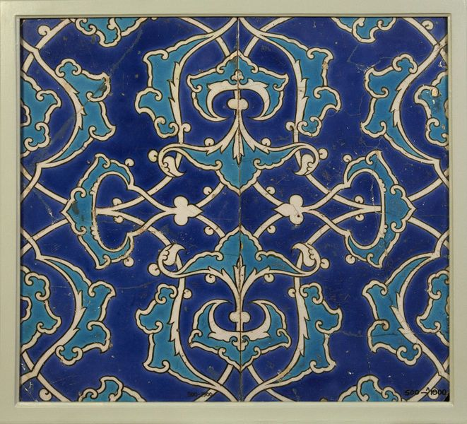 Tile | Made in Iznik, Turkey, 1550-1600 | Materials: fritware, polychrome underglaze painted, glazed | Tile of fritware painted in underglaze colours. Decorated with interlacing arabesques in turquoise-blue and white, outlined in olive-green on a dark blue ground | VA Museum, London