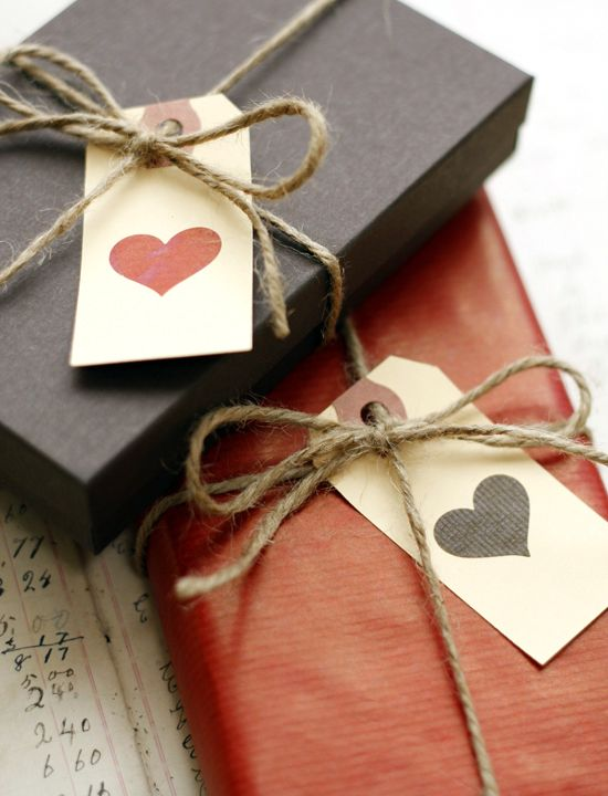 Simple tags adorned with a heart and tied with a piece of twine to gift boxes.