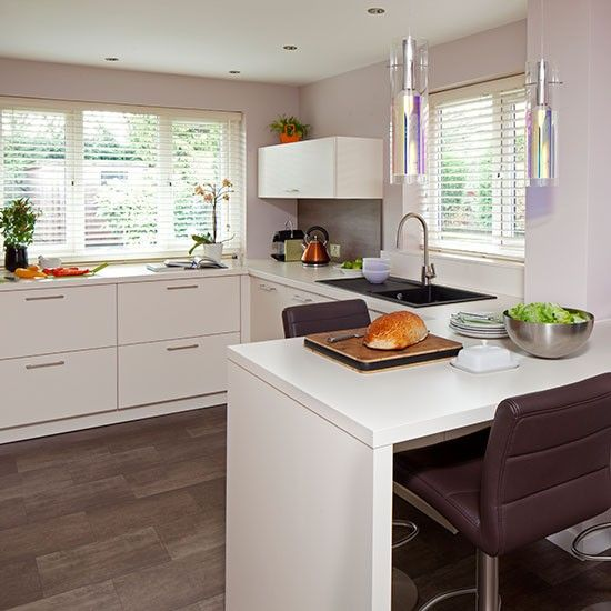 Modern white kitchen with leather stools|kitchen decorating
