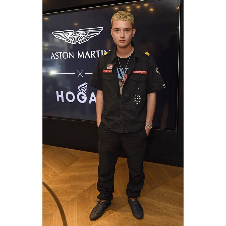 Dashing @raff_law wearing #ASTONMARTINxHOGAN limited edition Olympia #sneakers at #LFW event