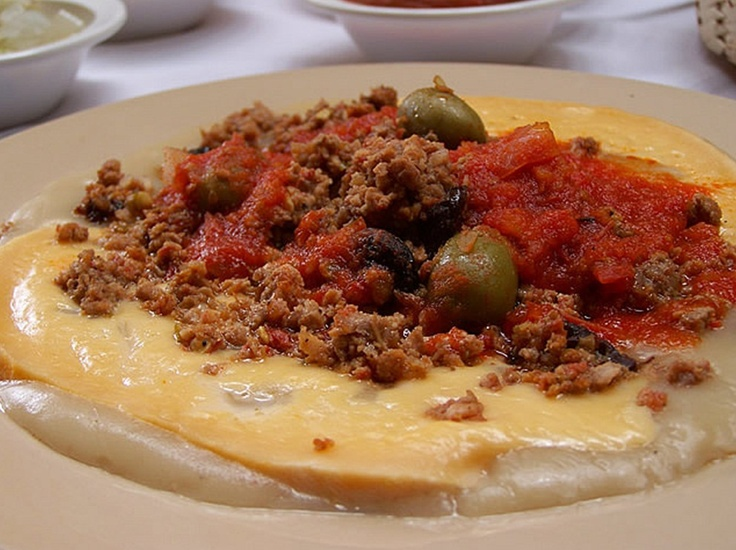 queso relleno, traadicionall Yucatecan dish, made with Edam cheese fill with picadillo, and habanero sauce to spice. Muy rico!!!!!!